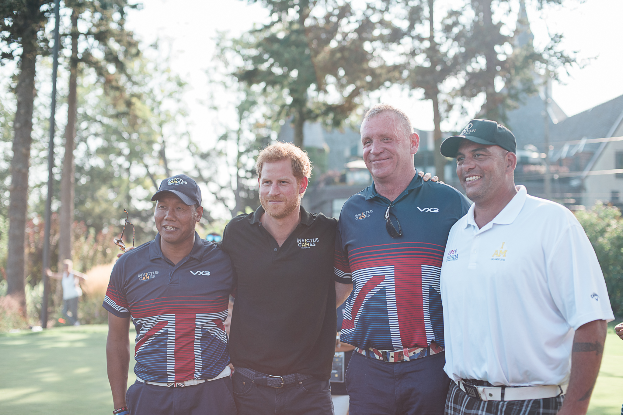 Prince Harry poses with members of the UK's Invictus Golf Team.